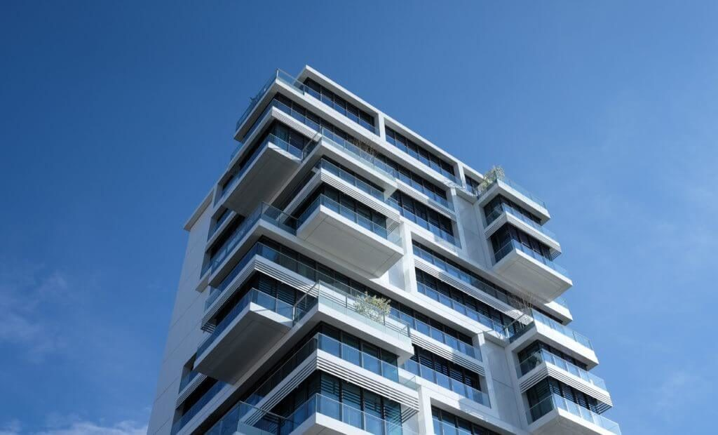 Image of modern apartment building that utilises strata management services